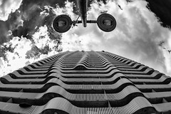 The Lamp and the Balconies (laga2001) Tags: balcony facade vienna structure pattern black white bw monochrome texture pov lamppole sky clouds architecture geometry