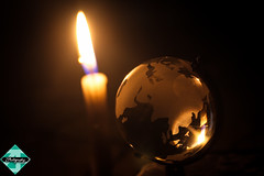Heal The World (shamahzoha) Tags: flickrfriday inthecandlelight candle earth globe glass crystal beautiful flame orange golden silver silhouette shadows dark darker shade abstract colorful colors vibrant warm macro