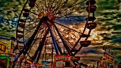 big wheel at sunset (migueldeozarko) Tags: sunset ferriswheel fair