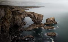 Heights (jellyfire) Tags: coast distagont3518 landscape landscapephotography limestone sea sony sonya7r stackrocks thegreenarchofwales water ze zeissdistagont18mmf35ze arch cliffs leeacaster pembrokeshire summer wales wwwleeacastercom zeiss