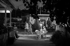 Artist At Work (Number Johnny 5) Tags: night tamron d750 2470mm street corfu holiday light monochrome shadows nikon urban sidari candid artist dark black nightlife movement noir bw people 2017 white