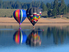 Kayaker and Balloons (Jeffrey Sullivan) Tags: hot air balloon reflections tahoe national forest prosser reservoir truckee california usa north outdoor adventure travel photography canon powershot g5 photo copyright 2004 jeff sullivan july kayak boating flat water