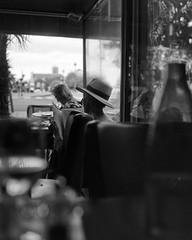 Paris - Cafe Style (* Daniel *) Tags: polaroid 110a polaroid110a polaroidlandcamera polaroidpathfinder markdaniel markdanielphotocom pancro pancro400 bergger berggerpancro400 sheetfilm 4x5sheetfilm pancro400sheetfilm berggerpmk pmk pyrodeveloper pyro berggerpancro400sheetfilm paris france street streetphotography streetphoto streetportrait mono monotone