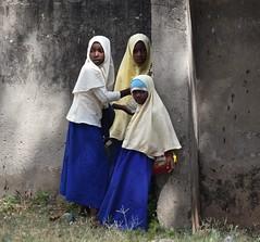 Youthful Drama (The Spirit of the World) Tags: school children girls habibs schooluniforms light shadows post candid zanzibar tanzania eastafrica africa island