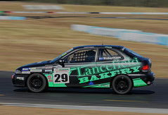 On the charge (geoffreywhitehouse) Tags: motorsport car autosport motorracing carracing queenslandraceway