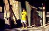 """""""Little Girl of an Cham Village in Vietnam"""" © 15. August 2017 by Silva Wischeropp aka Silva Capitana (SILVA CAPITANA) Tags: vietnam nhatrang chamdorf gruen gelb braun holzhaus holztuer einfachesleben armut ethnischeminderheit suedvietnam asien suedostasien leuchtendesgelb mädchen kleineskind kindheit holzhuette licht schatten dokumentation sozialreportage child childhood reportage travel asia southeastasia village chamvillage chamminority yellow green kids house farmhouse poverty children humanbeing savethechildren woodenhouse woodendoor greendoor shadows documentation dailylife socialreportage streetlife socialdocumentation ourbeautifulchildren longshadow analog analogphotography photo vietnamtravel passagetovietnam beautifulgirl innocence travelphotography savetheworld portrait childrenportrait portraits südvietnam southvietnam childrensworld analogefotografie reise reisefotografie grün holz kinder ngc"""