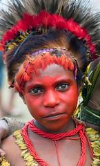 young girl red face (kthustler) Tags: goroka singsing papuanewguinea tribes huliwigmen mudmen