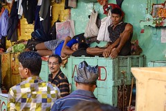 I see you, wholesale market, Calcutta (Yekkes) Tags: asia india kolkata calcutta market bazaar people workers merchants resting aloneinacrowd contemplation thinking looking seeing chaos green