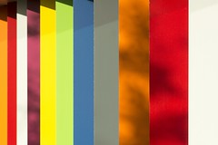 Colored pillars and shadows (Jan van der Wolf) Tags: 160181 colorspectrum colours abstract rainbow herhaling repetition biblion architecture perspective