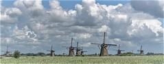 Guards of the polder (zoomleeuwtje) Tags: kinderdijk holland netherlands alblasserwaard molens mill mills windmill windmills clouds sky