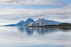 Dønna and Dønnamannen (Einar Schioth) Tags: helgeland dønna dønnamannen sky summer sea sun shore day canon clouds cloud coast vividstriking nationalgeographic ngc norway norge nature mountains mountain landscape photo picture outdoor einarschioth