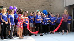 The moment at last - Erica Kearney cuts the ribbon to announce the new May Center School in West Springfield officially open.