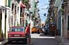 Old City Street In Havana (kaprysnamorela) Tags: oldcity havana street cars people sky houses buildings perspective converginglines balcony cuba nikond3300 shadow