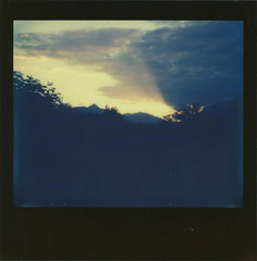 Glowing Rays (sycamoretrees) Tags: analog blackframe blackframeedition clouds colorspectra colorspectra201612 evening film impossible instantfilm integral integralfilm marianrainerharbach polaroid sky spectra sun sunset