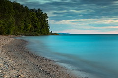 Big Blue Motion (matthewkaz) Tags: lakemichigan lake water greatlakes clouds sky longexposure beach sand shore shoreline coast coastline trees christmascove christmascovebeach leelanau leelanaupeninsula puremichigan summer michigan 2017 northport