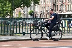Calling Elvis (FaceMePLS) Tags: amsterdam nederland thenetherlands facemepls nikond5500 straatfotografie streetphotography man fiets fietser bellen mobieltje gsm cellphone handy kinderzitje kratje rugzak damesfiets bike bicycle batavus adidasstansmithsneakers tweewieler