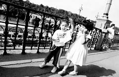 Prague 1981 (kirstiecat) Tags: shadows girls kids sisters bridge prague praha prag monochrome monochromemonday blackandwhite noiretblanc