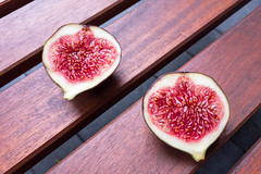 Cross section of two figs: fruit pulp and seeds (marcoverch) Tags: köln nordrheinwestfalen deutschland de cross section figs fruit pulp seads food lebensmittel sweet süs frucht wooden hölzern table tabelle wood holz noperson keineperson healthy gesund nutrition ernährung delicious köstlich seed samen tasty lecker tropical tropisch juicy saftig refreshment erfrischung health gesundheit diet diät exotic exotisch confection konfekt cut schneiden olympus eos analog noiretblanc animals photoshop la pet pumpkin rural