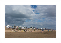 Twenty Five Beach Huts (prendergasttony) Tags: beach sand hut sky clouds lancashire nikon d7200 elements outdoors seaside coastal shore vacation holiday blue people harbour wall england stannes chalet ansdell lytham festival