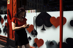 All my colours 94/156 (Explore 2/9/2017) (markfly1) Tags: all colours red black white yellow street candid woman phone playing cards hearts clubs spades diamonds d750 35mm lens