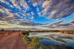 Walker, there is no path, the path is made by walking (Peideluo) Tags: camino clouds nubes paisaje agua reflejos reflection cielo laguna