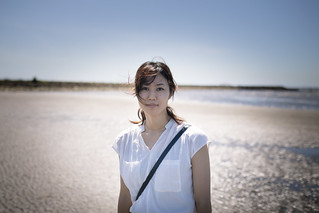 Portrait of beautiful Japanese woman standing on beach
