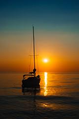 Sunset at anchor (Paladin27) Tags: sailboat sailing hunter23 hunter h23 lakemichigan lake michigan sun sunset silhouette anchored anchor mast evening summer