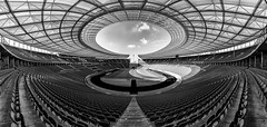 Hole in the Roof (laga2001) Tags: black white bw monochrome architecture berlin olympia stadium roof football geometry wideangle panoramic seats grass sky clouds empty light shadow sport athletics public soccer olympics arena