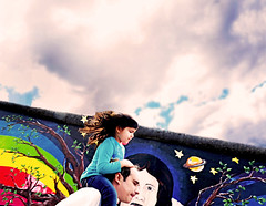 Berlin (kirstiecat (on vacation...)) Tags: berlin berlinwall eastsidegallery germany child kid daughter flare surreal dream parent father mural art graffiti magicalrealism saturation colours colors life moment experience street canon cinematic