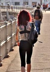 Hastings Promenade - May 2017 - Body Art Gallery (Gareth1953 All Right Now) Tags: candid beautiful skinny young woman girl hastings promenade walking redhead red hair tattoo tattooedbody back leggings visible bra hairy arms flowers rucksack flowertattoo tattooedback bodyart