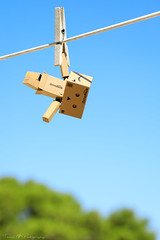 I believe I can fly... (Thieu | Photography) Tags: canon5dmarkiv amazon suspended clothespeg funambulist canon blue 5d4 danboard 5dmarkiv clothespin 5div tightropewalker sky danbo toy fun hanging help