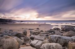 sunset at the beach (Marlis B) Tags: ireland sunset blue hour longexposure stones beach