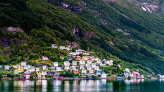 Odda (Tommy Høyland) Tags: noruega landscape reflection outdoor structure clouds norway water waterfall shore fjord building northern architecture green nobody village colourful mountain