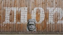 Medieval stone face carried by cartoon workmen - Construction fence at the Musée de Cluny, Paris (Monceau) Tags: medieval stone face carried cartoon workmen letters fence wood construction muséedecluny paris