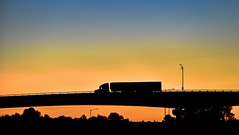 Semi sunset (Christie : Colour & Light Collection) Tags: truck semitruck silhouette bigrig semi semitrailer sundown bridge transporttruck truckcab light evening outdoors lightstandard glow transportation goldenearsbridge bc canada