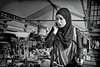 jumble sale visitor (digitris) Tags: candid street market rommelmarkt jumblesale bw blackandwhite monochrome digitris digitri streetphotography city people woman mother hijab