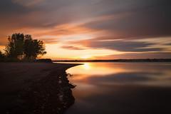 Sunrise Streaks (mclcbooks) Tags: chatfieldstatepark lakechatfield colorado sunrise dawn daybreak morning clouds reflections trees silhouettes landscape le longexposure