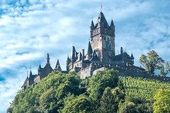 Reichsburg Cochem (enneafive) Tags: cochem germany moselle castle sky clouds green trees hill vineyard