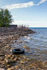 Tire On The Beach (k009034) Tags: 500px trees sky city sea nature travel clouds waves rocks summer fence black waste tire rubber rubbish tallinn estonia tranquil scene copy space baltic destinations countries teamcanon