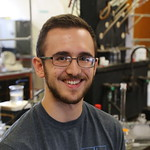 A student in the lab poses for a photo