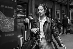 Pleated (Leanne Boulton) Tags: people monochrome portrait urban street candid portraiture streetphotography candidstreetphotography candidportrait streetportrait streetlife woman female girl pretty face facial expression look emotion feeling mood style movement leather jacket mobile phone music tone texture detail depthoffield bokeh naturallight outdoor light shade shadow city scene human life living humanity society culture fashion canon canon5d 5dmkiii 70mm ef2470mmf28liiusm black white blackwhite bw mono blackandwhite glasgow scotland uk