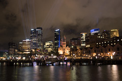 Sydney Alive with night lights (Frances Jayne) Tags: sydney festival vivid buidings skyscrappers beam light night winter dark water habour