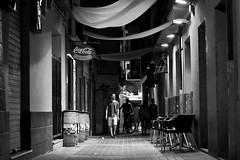 Night scene (Daniel Nebreda Lucea) Tags: night noche city ciudad street calle urban urbana urbano canon 50mm monochrome monocromatico black white blanco nero texture extura lights luces shadows sombras people gente walk andar andando dark oscuro old viejo antiguo zaragoza aragon spain españa floor suelo bar pub man hombre