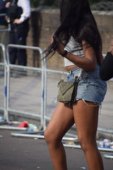 DSC_3371 Notting Hill Caribbean Carnival London Aug 28 2017 Girl with Cut-off Denim Blue Jeans (photographer695) Tags: notting hill caribbean carnival london exotic colourful costume dancing lady showgirl performer aug 28 2017 stunning ladies girl with cutoff denim blue jeans