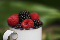 Healthy fruit - Help yourself :-) (eleni m (busy remodeling house)) Tags: macromondays hmm stayinghealthy fruit summer summerfruit macro outdoor raspberries nuggin enamel blackberries