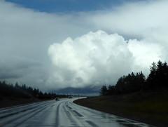 Sunshine, clouds, and rain (yooperann) Tags: weather m553 gwinn upper peninsula michigan cumulus clouds wet highway road rain