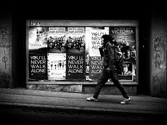 You'll Never Walk Alone (Sandy...J) Tags: walking monochrom man street streetphotography blackwhite bw urban city noir olympus