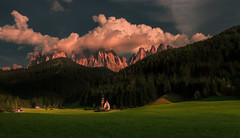 Country scene 山坡下 (kaising_fung) Tags: italy dolomites alps church small clouds mountains peaks cliff meadow woods forest farm light travel green