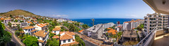 Funchal Panorama (Wolfhowl) Tags: view palms sunny landscape europe roofs mountains city cityscape panorama building buildings portugal rooftops trees seaview 2017 road construction atlantic blue ocean august sky island summer apartment hills madeira
