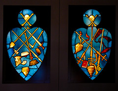 Royalty and Clergy (Steve Taylor (Photography)) Tags: stainedglass victoriaandalbertmuseum va museum sword crown mitre skullandcrossbones spear staff shovel spade pike art window black blue gold red uk gb england greatbritain unitedkingdom london shape